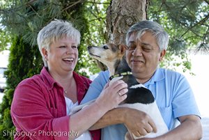 While owner Manny Gomez holds Lucy, the dog tries to give Gomez's wife, Lori Massie, a kiss on the cheek.