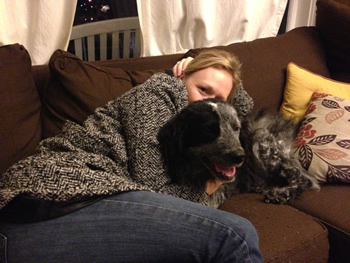 "On a cold winter evening, Herz and Jackson cuddle on the couch in their black-and-gray ""outfits."""