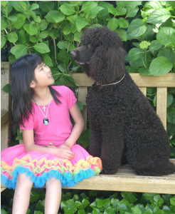 Madeline Urban, 7, is one of Riley's biggest boosters. After Riley is retired in late April, the dog will be returned home to her parents in Issaquah, where Madeline will see her more often.