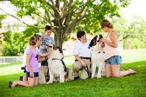 Bill and Laura Gordons' St. Bernards, Rosie and Clarence, were popular with parents and children at the Newtown thank-you ceremony for the therapy-dog teams in late June. The Gordons are Greenfield, Mass., police officers.