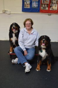 Following an agility practice, Timbers relaxes with Anja, left, and Loki, her prime de-stressors from her 911 call-taking position.
