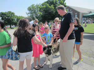 Students and parents always surround Cole and Spartacus, probably the most identifiable therapy-dog team in Newtown. The pair was there to help from the day of the shootings until June 21, the final day of school.